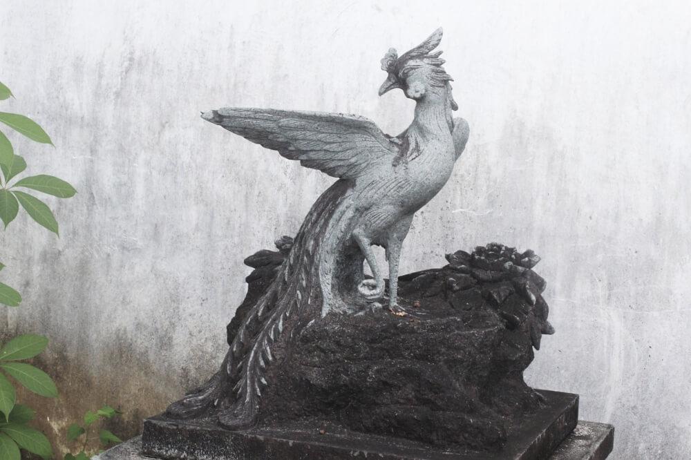 mito-fenice-statua-photos-asia-vento-cina-pietra-